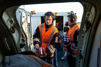 Matt Bradley and Matt Pettinger help load a Southwest Airlines flight