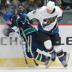 Matt Pettinger checks a Canuck
