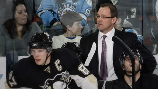 Dan Byslma behind the penguins bench