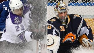 Dustin Brown cover in a snow showered while Ryan Miller makes a save