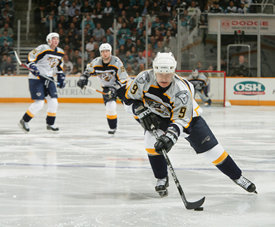 Paul Kariya with Jerred Smithson and Brendan Witt in background