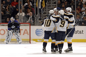 Paul Kariya and teammates celebrate a goal