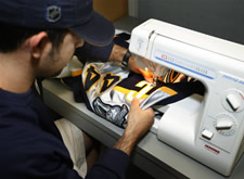 Sewing the 'C' onto Timonen's jersey