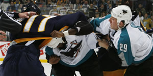 Sharks forwards Ryane Clowe and Mike Grier engage Predators forward Scott Hartnell