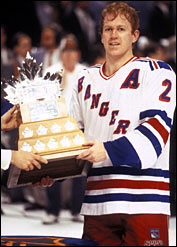 Brian Leetch accepts the Conn Smythe Trophy as Stanley Cup playoff MVP in 1994.