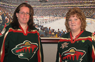 Mary Letourneau and Eva McClellan (Left to Right) have attended every home Wild game
